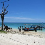 Locals unloading supplies from Lombok